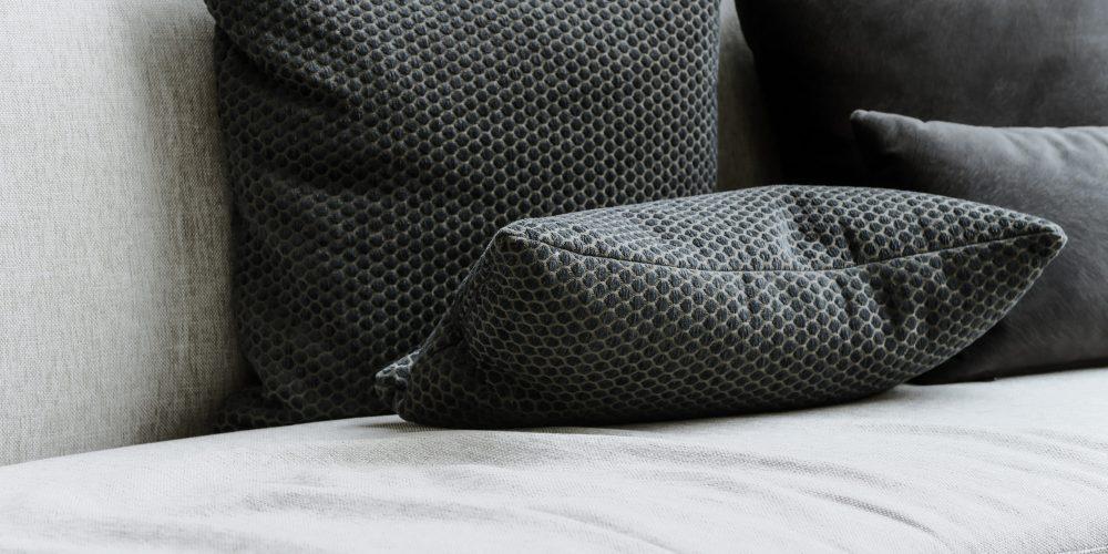Detail image of cushion on sofa, modern living room.